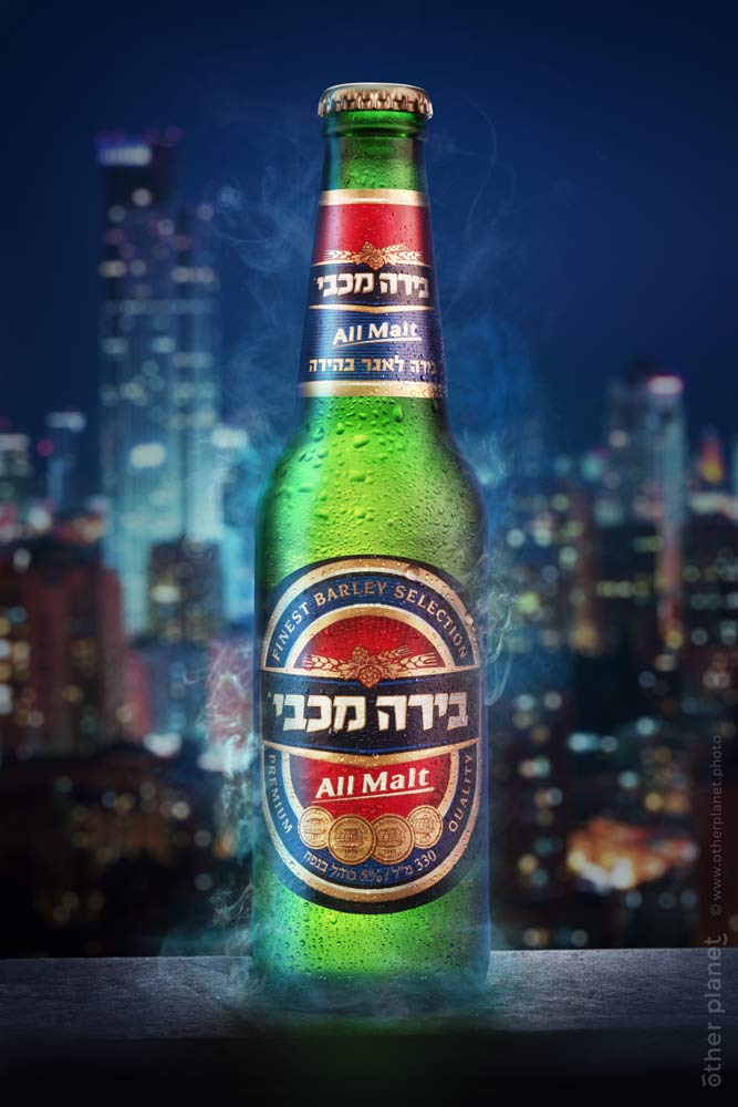 Advertising image of Maccabi beer on night city background