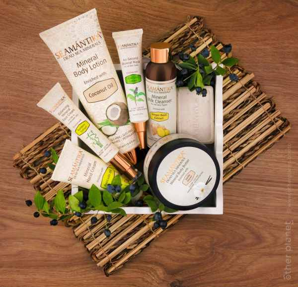 Arrangement of Semantika cosmetic products on wooden background top view