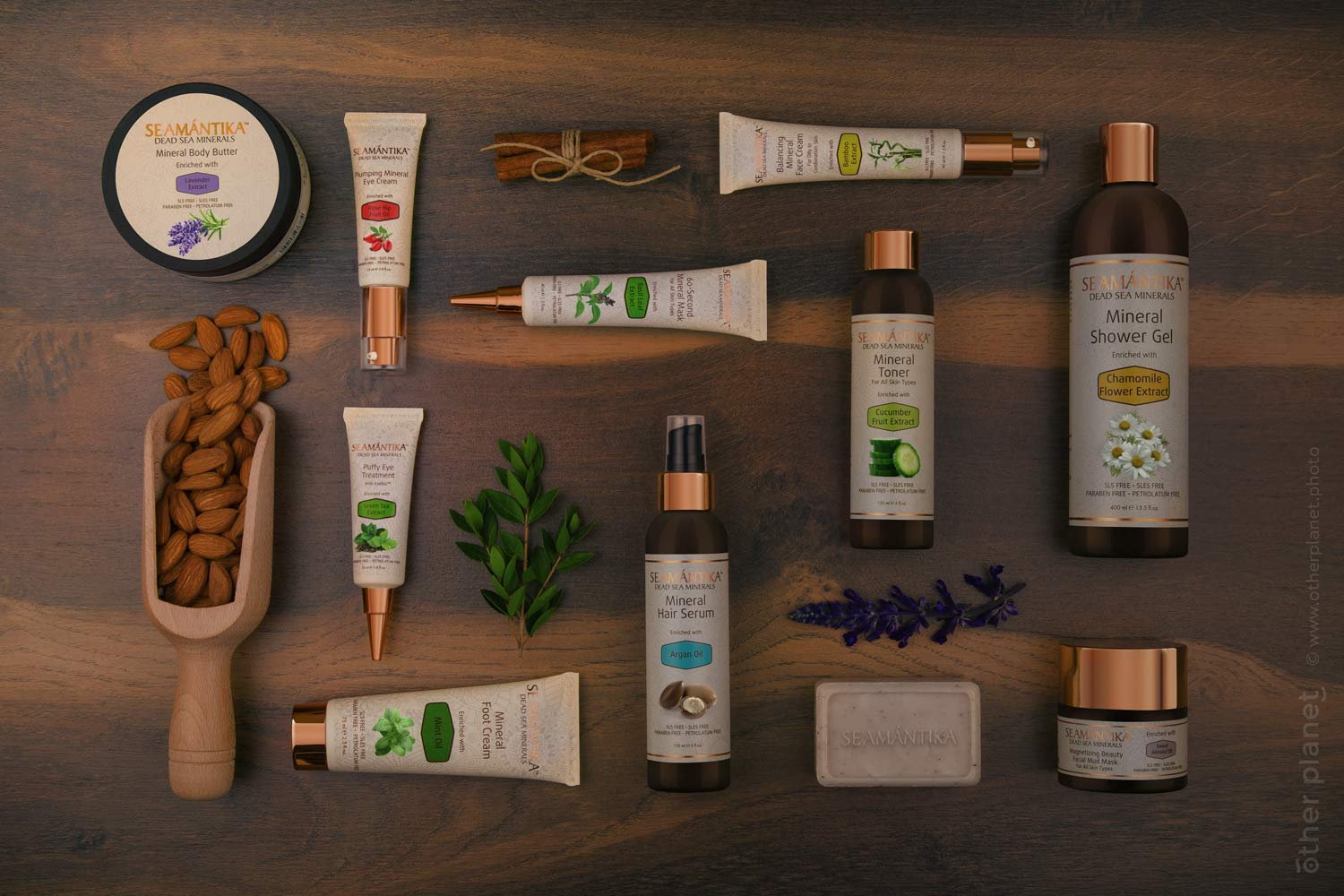 Arrangement of Semantika products with plants on wooden table top view
