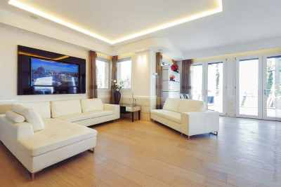 Big living room interior with beige sofas