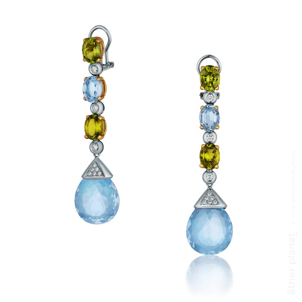 Blue Oval topaz earrings photography for Hanna Olenik