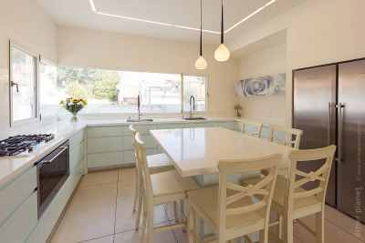 Bright yellowish kitchen with built in fridge