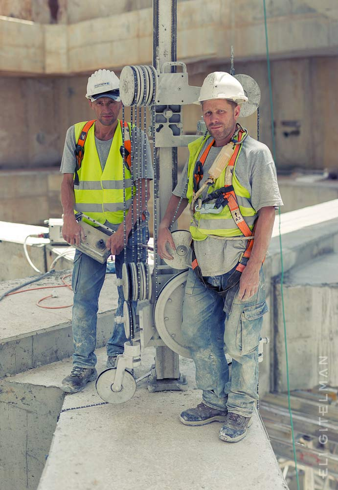 Concrete sawing professionals at a construction site