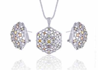 Diamond jewelry set of three items on white with reflection