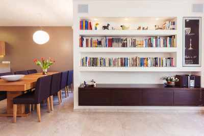 Dining room shared space decorated with bookshelves