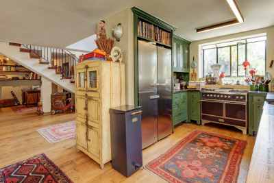Eclectic style kitchen with green cupboards