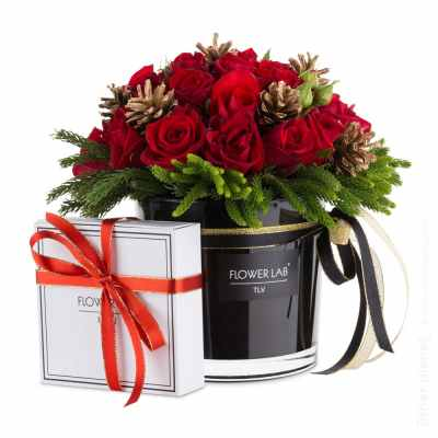 Flower arrangement with pine cones and gift box