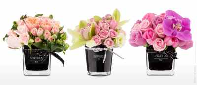 Flower arrangements in black vases