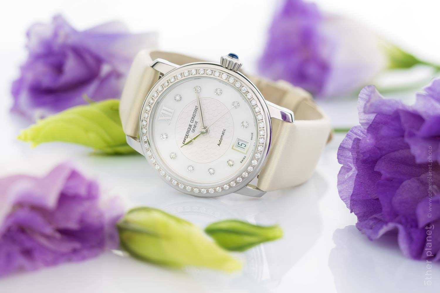 Frederique constant women light watch surrounded by flowers