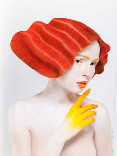 Girl with yellow hand and red hair - shot for hair dressing academy