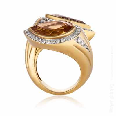 Gold diamond and gems ring side angle photography