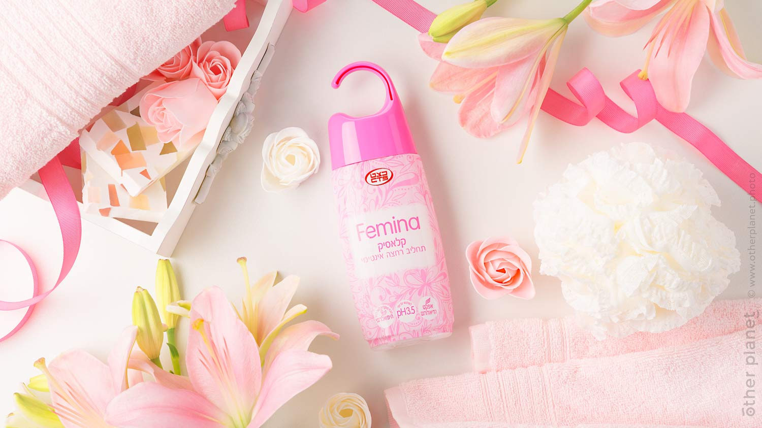 Group arrangement of Femina hygienic soap with lily flowers