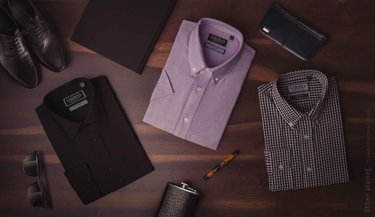 Group arrangement of folded men shirts with accessories top view