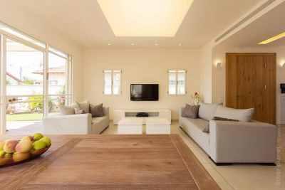 Interior design of living room in beige tones with large window