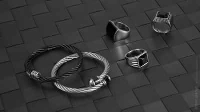 Jewelry for men arrangement on black wicker texture