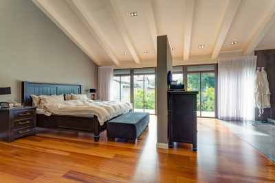 Large bedroom with big windows and authentic parquet floor