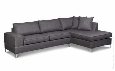 Large corner gray sofa with cushions on white background