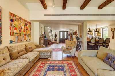 Living room interior in eclectic retro style view of front door