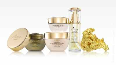Photo of cosmetic products with gold