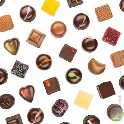 Praline chocolates on white background