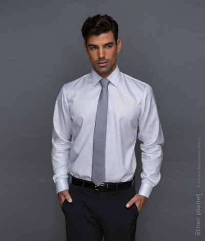 Studio shot of male model wearing white shirt and a tie on grey background