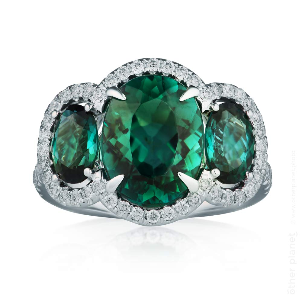 Three big emeralds ring with diamonds