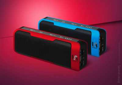 Two portable speakers on red background