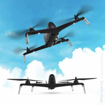 Two quadcopter drones flying in the sky and standing on white