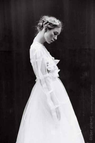 Wedding dress by Sanra Gutsati black and white side view