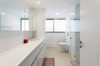 White and clean bathroom interior - view on the window