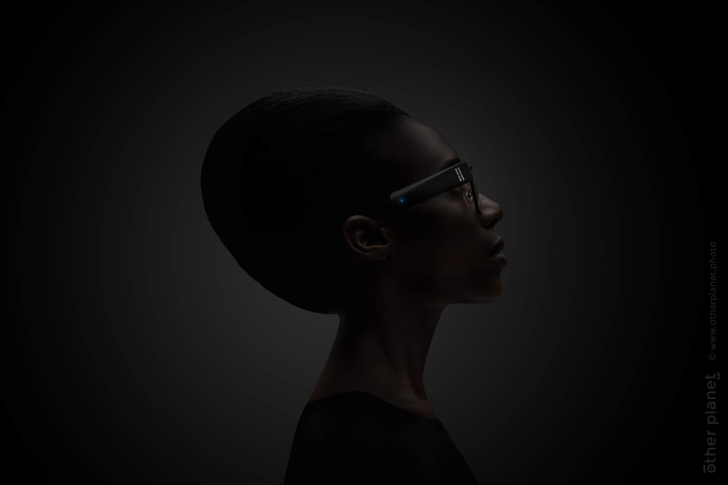 Woman wearing Orcam Mye Eye on black background