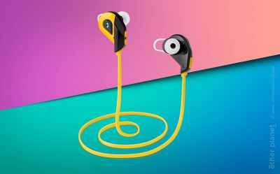 Yellow earphones on geometric background