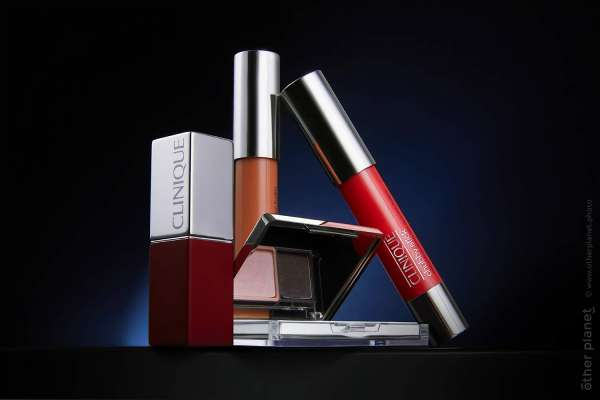 Advertising Photo of Clinique Cosmetics, lipstick, lips gloss, shadows - on dark background