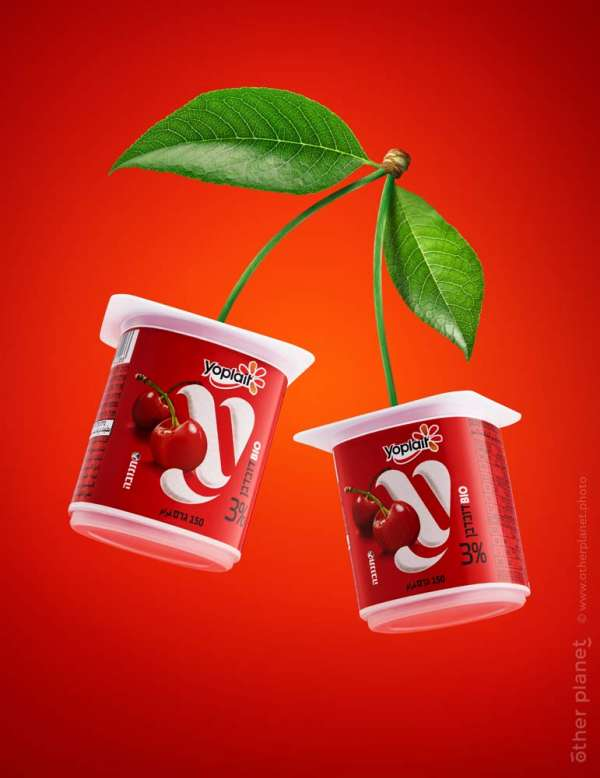 Yoplait Yogurt Cherry 3% Tnuva shown as cherry with leaves on red background
