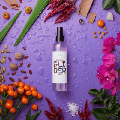 Cosmetics advertising photo with plants and flowers on vibrant background