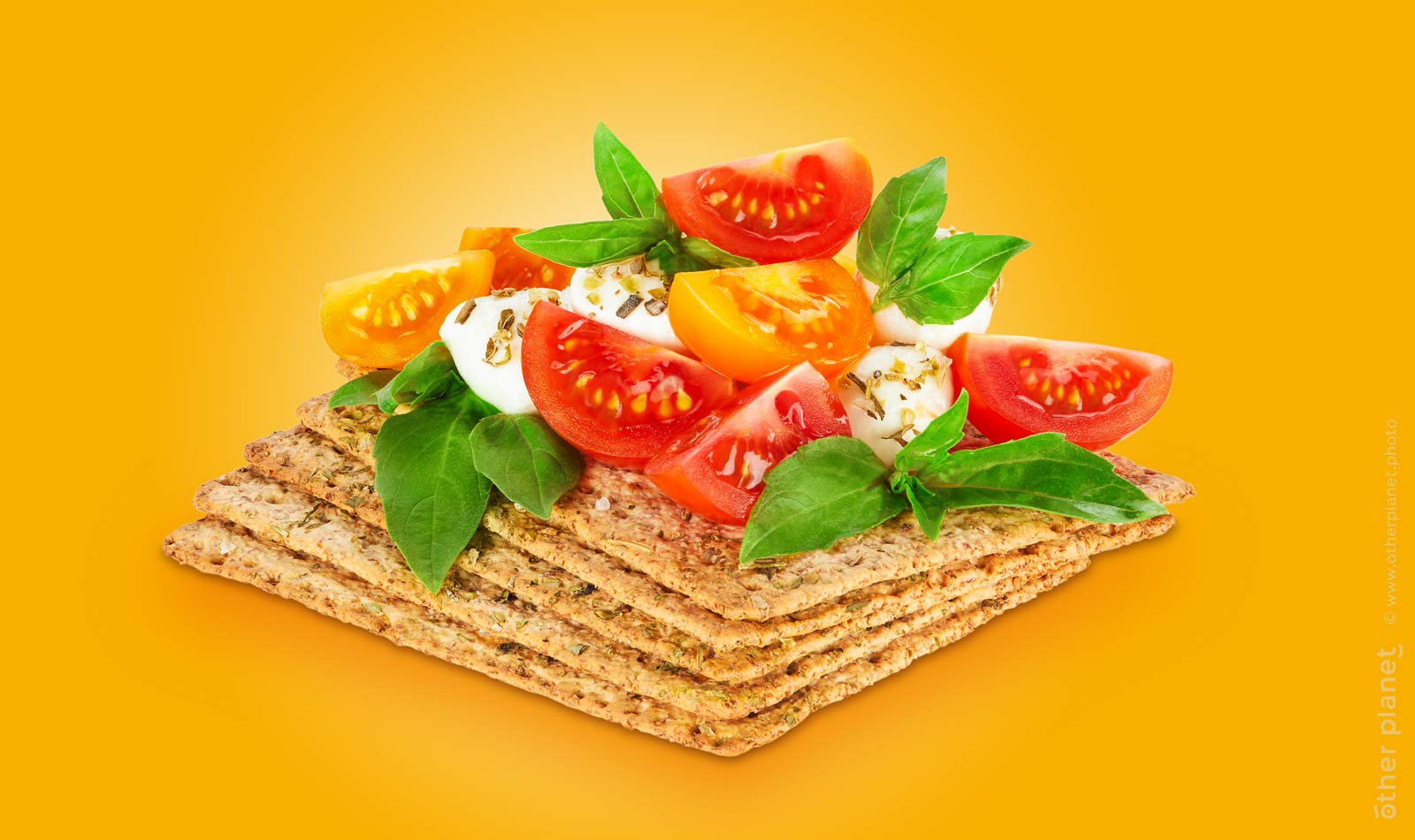 Food appeal photo for whole grain crackers with cherry tomatoes basil and mozzarella