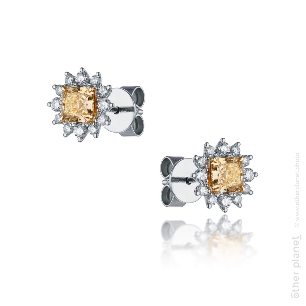 Jewelry earrings with diamonds and yellow topaz packshot