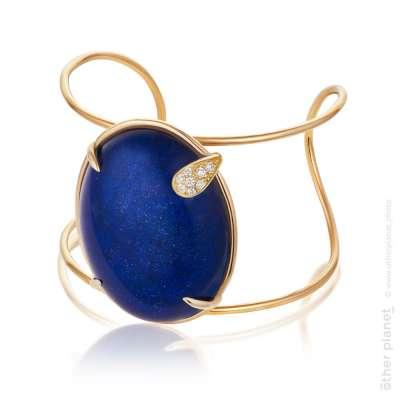 Jewelry golden bracelet on white background