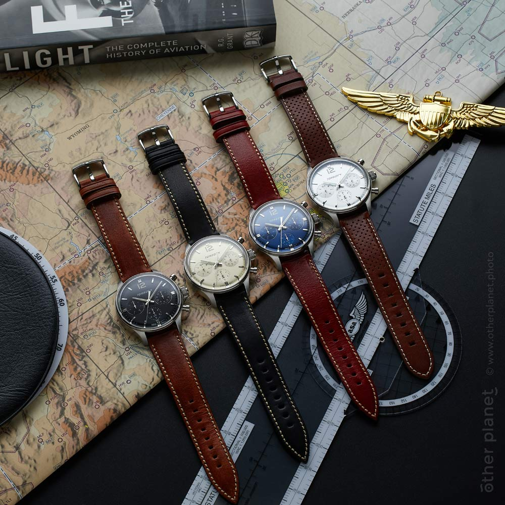 Luxury aviator watches photography with map and aviation badge