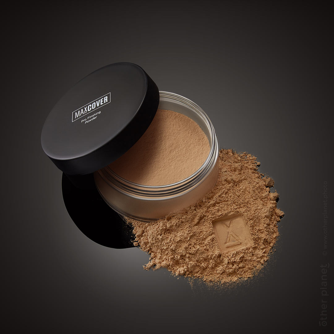 cosmetics packshot powder on black background with stamp