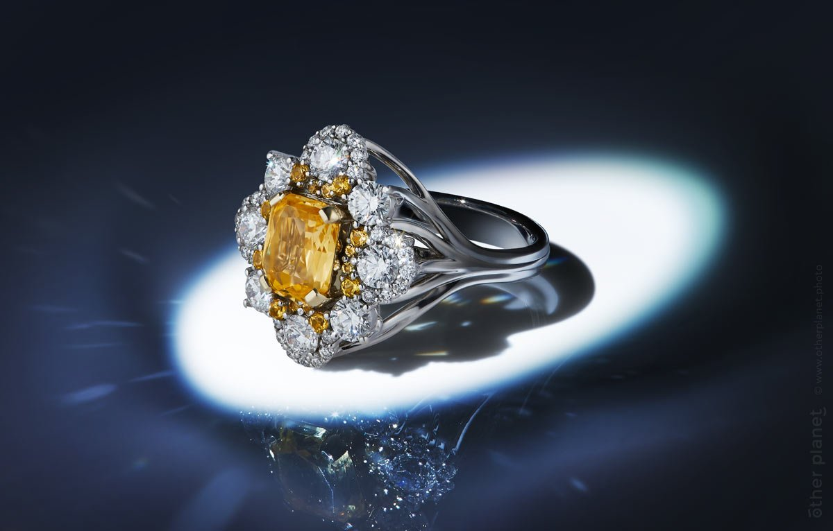 jewelry product photography on dark background diamond ring with topaz