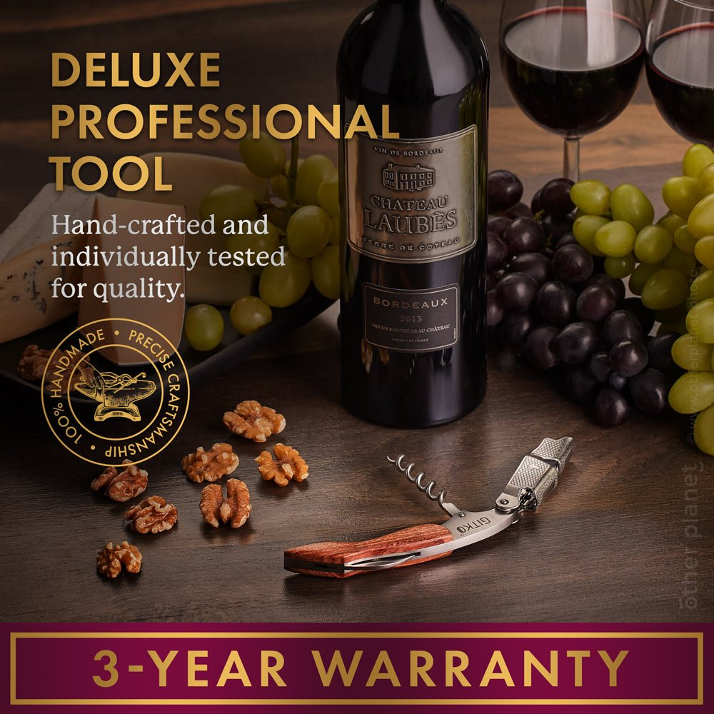 Wine opener wine and grapes classic product photography